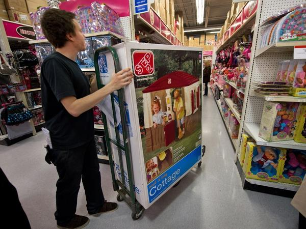 A stock clerk working on Black Friday moves merchandise into position at a Toys R Us store in Fairfax, Va. Retailers added 50,000 jobs in November.