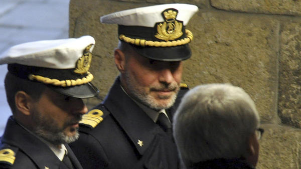 Italian coast guard Capt. Gregorio De Falco (center) has become a national hero for ordering the captain of a sinking cruise liner to get back onboard and oversee the ship's evacuation. Here, De Falco arrives in court for a hearing on Tuesday.