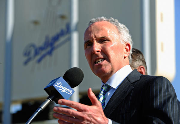 Los Angeles Dodgers owner Frank McCourt speaks at a news conference on April 14, 2011, in Los Angeles, about safety issues following a fan attack at Dodger Stadium on opening day of 2011. McCourt has put the team up for sale, and bids from buyers are due on Monday.