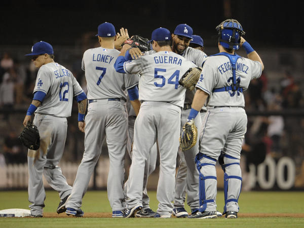 Los Angeles Dodgers players high-five after beating the San Diego Padres 2-0 at Petco Park in San Diego on Sept. 23, 2011.