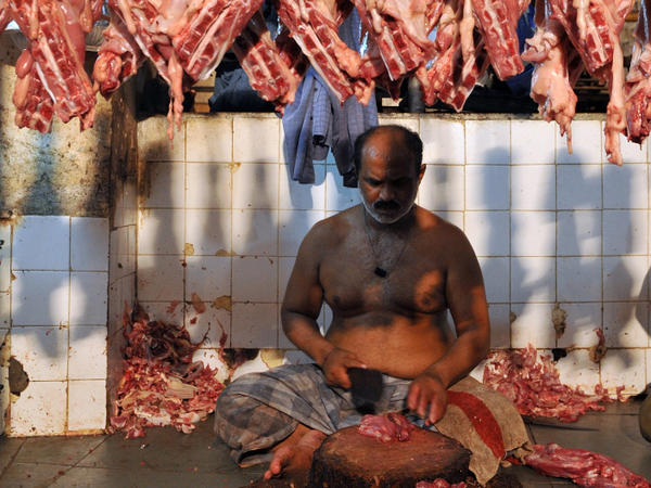 An Indian butcher chops meat at a mutton market in Mumbai. Indians are consuming more meat than ever before, despite a tradition of vegetarianism.