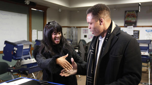 Rep. Jesse Jackson Jr. and his wife, Chicago alderman Sandi Jackson, ask each other for their support and votes as they arrive at a polling station for early voting in Chicago on March 9.
