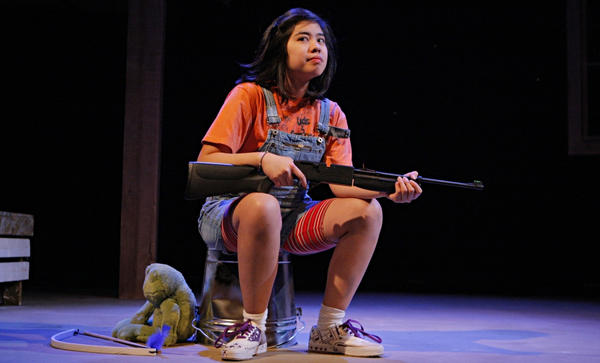 Isabella Dawis plays the protective 12-year-old Edith in the Mu Performing Arts production of <em>Edith Can Shoot Things and Hit Them,</em> by Rey Pamatmat.