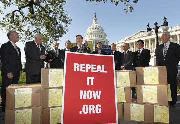 Sen. Jim DeMint, R-S.C., center, joins other conservative lawmakers on Capitol Hill to criticize President Obama's health care law on Oct. 5, 2011.  They said the boxes were packed with petitions asking Congress to repeal the Affordable Care Act.