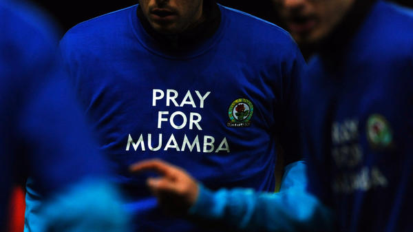 Blackburn Rovers players wear T-shirts in support of Bolton Wanderers' midfielder Fabrice Muamba.
