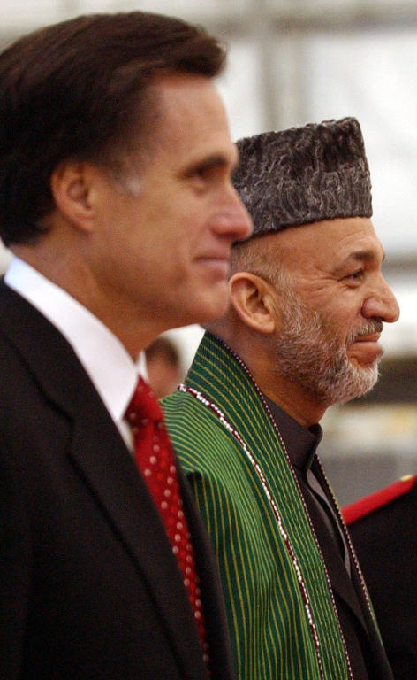 Then-Massachusetts Gov. Mitt Romney greets Afghan President Hamid Karzai on May 21, 2005, at Logan Airport in Boston.