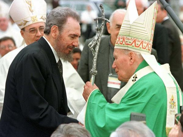 Cuban leader Fidel Castro greets Pope John Paul II after the pope's historic Mass in Havana's Plaza of the Revolution on Jan. 25, 1998.