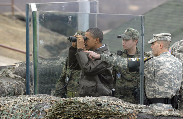 President Obama looks toward North Korea from a post on the South Korean side of the DMZ, the tense military border between the two Koreas, on Sunday. At right is U.S. Lt. Col. Ed Taylor, commander of the U.N. Command Security Battalion-Joint Security Area.