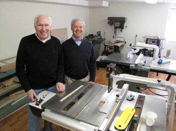 "The table saws in David Butler's (left) workshop are outfitted with prototypes of his ""Whirlwind"" safety brake system. He and his lifelong friend Robert Calhoun filed their first Whirlwind Tool Co. patent in 2009."