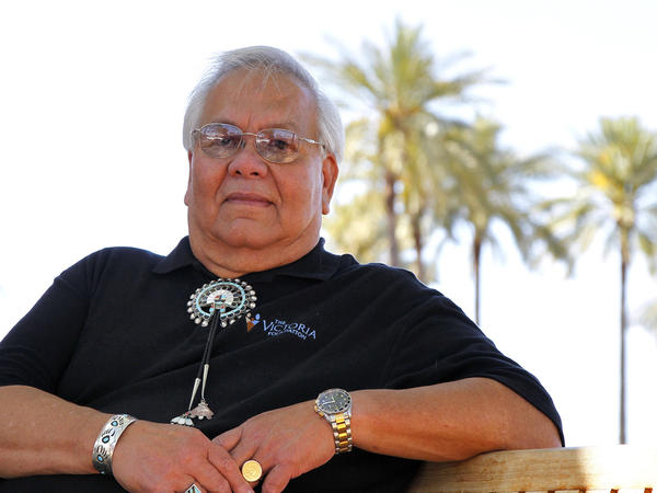 """Jim Shee, shown in Scottsdale, Ariz., on Friday, says he has been stopped twice by police and asked for his papers. """"I'm an American citizen and I am being stopped because of the color of my skin, what I look like,"""" he says."""