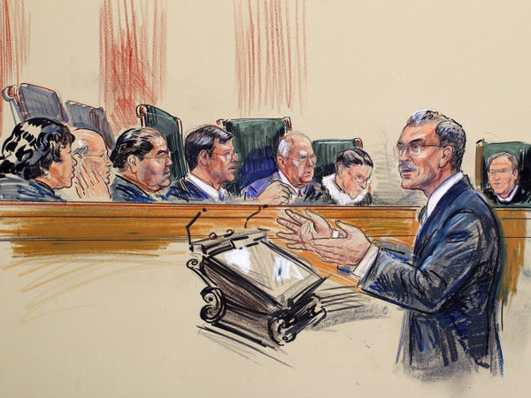 This artist rendering shows Solicitor General Donald Verrilli speaking before the Supreme Court. Verrilli argued Wednesday that Arizona's immigration law steps into federal territory.
