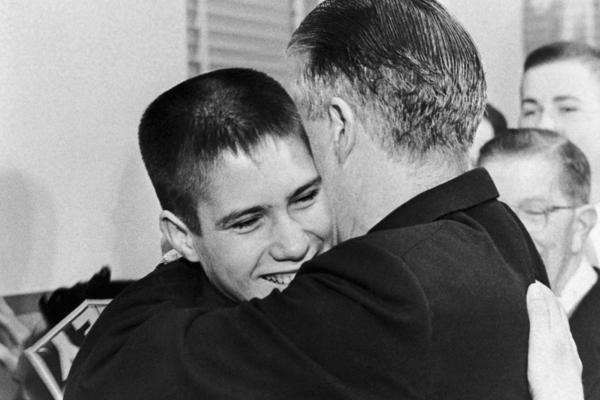 A 14-year-old Mitt hugs his father after George Romney announces his candidacy for governor on Feb. 10, 1962.