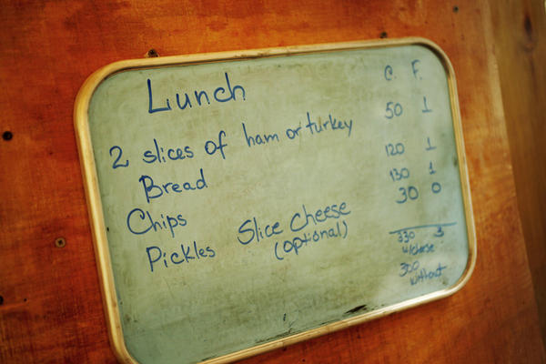 A board in the cafeteria breaks down the calories and fat grams for each meal.  A full salad bar is always offered.