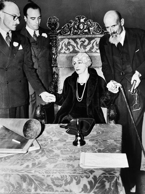 Bess Houdini, Harry's widow, held a series of séances after his death in an unsuccessful attempt to contact him in the afterworld. Here she is seen during her last séance, 10 years after his death. Bess died in 1943.