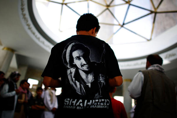 An Afghan youth prays over Massoud's grave.