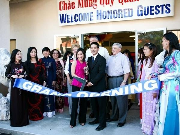 Tam Nguyen (center right) and his sister Linh run the Advance Beauty College in Garden Grove, Calif.