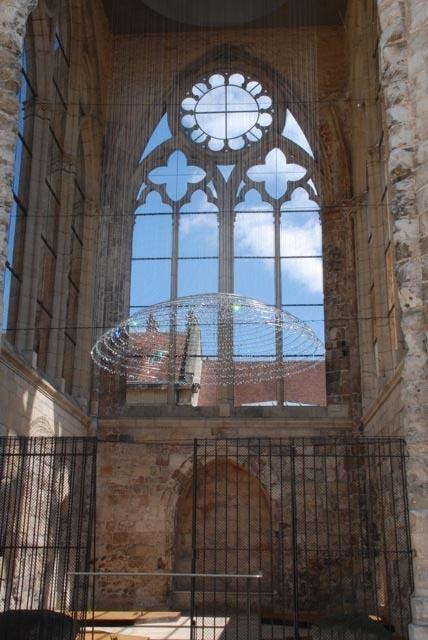 Cao and Perrot's <em>White Dome</em> hangs inside a free-standing tower that used to be part of Beauvais' Saint-Barthelemy Collegiate Church.