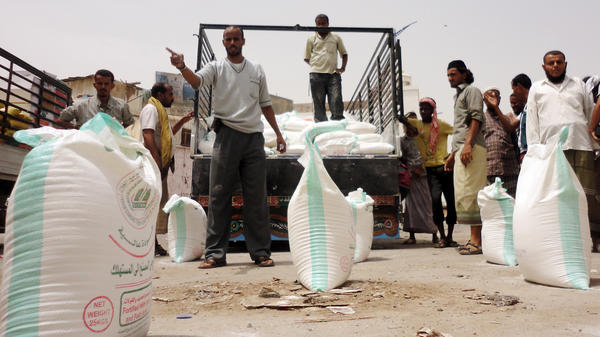 Displaced Yemenis receive food aid from the U.N. High Commissioner for Human Rights in the southern province of Abyan. While food is available in the country, many Yemenis cannot afford to buy it. About 10 million people are going hungry, aid groups say.