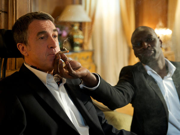 Driss and Philippe (Francois Cluzet) indulge in one of the shared vices that cement their friendship in <em>The Intouchables.</em>