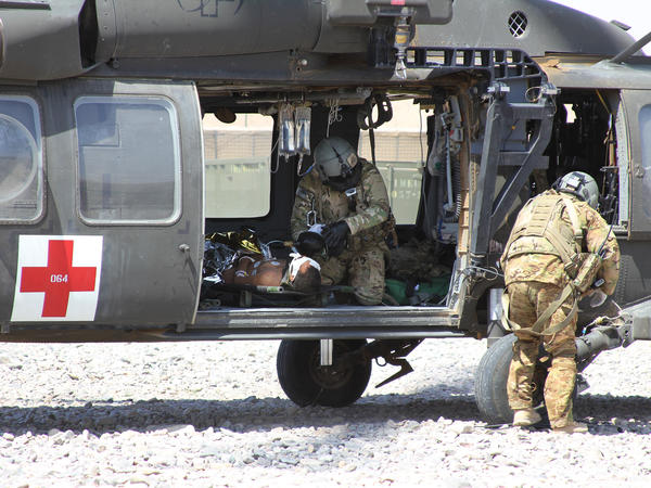 A NATO/U.S. medevac helicopter transports an Afghan civilian wounded by an IED near Camp Ricketts, a small NATO base in Muqur District, Badghis Province.