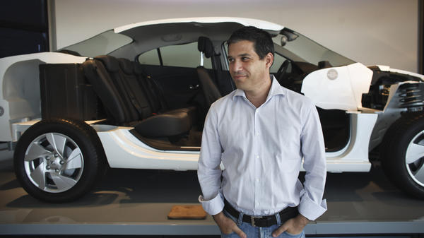 Better Place is building a network of electric car battery changing stations throughout Israel. The idea is to make changing a spent electric battery as easy as pulling into the gas station for gasoline. Here, Better Place CEO Shai Agassi is shown in front of a cutaway model of an electric car at the company's showroom in Tel Aviv earlier this month.