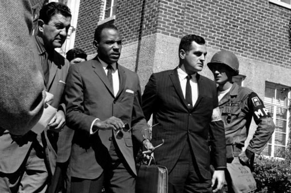 Meredith, center with briefcase, is escorted to the University of Mississippi campus by U.S. marshals on Oct. 1, 1962.