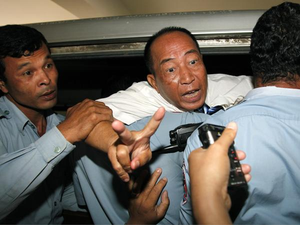 Supporters of Mam Sonando (shown here Monday after his conviction) say the pro-democracy activist drew the government's ire by trying to help farmers in eastern Kratie province protect their land. He also runs one of the few private broadcasters in the country that is critical of the government.