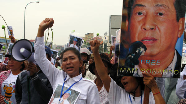Supporters of Cambodian journalist Mam Sonando protest outside a Phnom Penh courthouse on Monday, when judges sentenced him to 20 years in jail for leading an alleged secession movement. Critics say the pro-democracy activist's case was politically motivated.