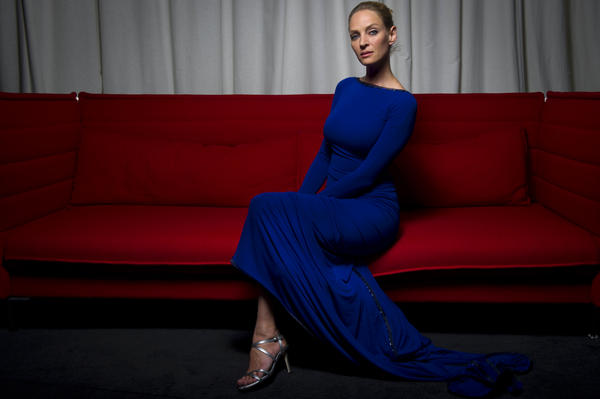 Actress Uma Thurman, 6 feet, poses during a photo session at the 64th Cannes Film Festival on May 22, 2011.