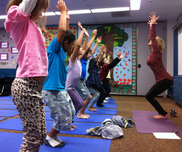 Third-graders at Olivenhain Pioneer Elementary School in Encinitas, Calif., perform chair pose with instructor Kristen McCloskey last month.