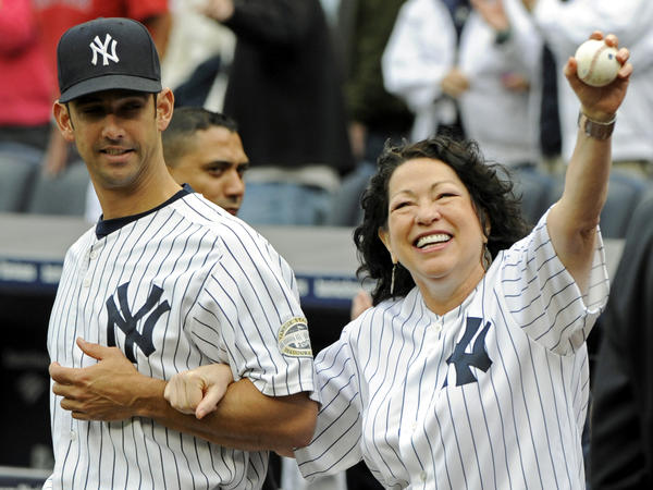 Sotomayor is escorted onto the field by New York Yankees catcher Jorge Posada to throw out the ceremonial first pitch before the New York Yankees game against the Boston Red Sox on Sept. 26, 2009 at Yankee Stadium in New York.