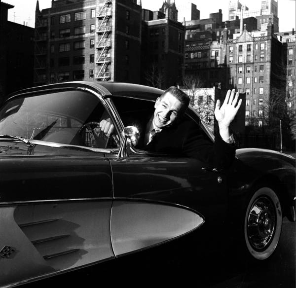 Johnny Unitas of the NFL's Baltimore Colts sits behind the wheel of his new fire-engine red Corvette in New York City, Dec. 31, 1958. The car was presented by <em>Sport Magazine</em> in recognition of Unitas' outstanding performance in the title playoff game.