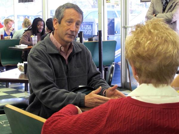 Former South Carolina Gov. Mark Sanford chats with a diner at a restaurant in Charleston, S.C. Sanford is one of 16 Republicans in Tuesday's GOP primary for the special election to fill the vacant 1st Congressional District seat.