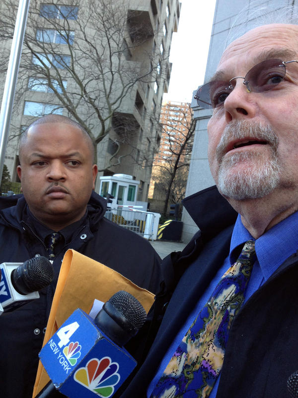 Adhyl Polanco, an eight-year police veteran (shown with lawyer Jonathan Moore, right), testified that if certain quotas were not met, an officer could be denied days off and overtime, and be given a poor evaluation.