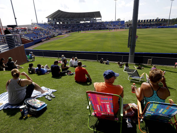 Baseball fans watch an exhibition spring training game between the Washington Nationals and the New York Mets in Port St. Lucie, Fla. Spring training contributes $35 million to the local economy.