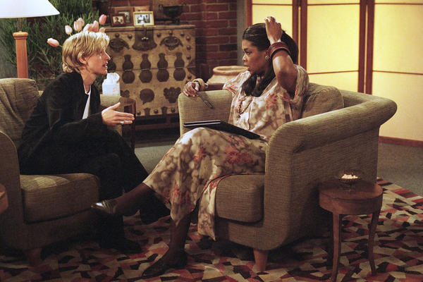 DeGeneres, playing the character Ellen Morgan, discussing her fears about coming out as a lesbian with her therapist, played by Oprah Winfrey, during the taping of the <em>Ellen</em> show in 1997.