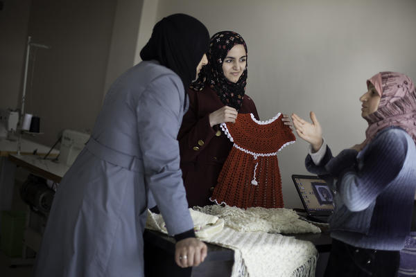 Marwa Sayd Essa (center), a Syrian architecture student, works with refugee women at a handicrafts program in southern Turkey.