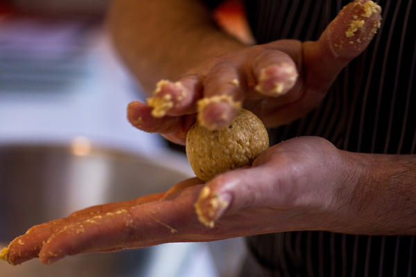 Barry Koslow, DGS executive chef, demonstrates the proper technique for rolling a matzo ball. His take on traditional matzo ball soup for Passover includes roasted bone marrow.