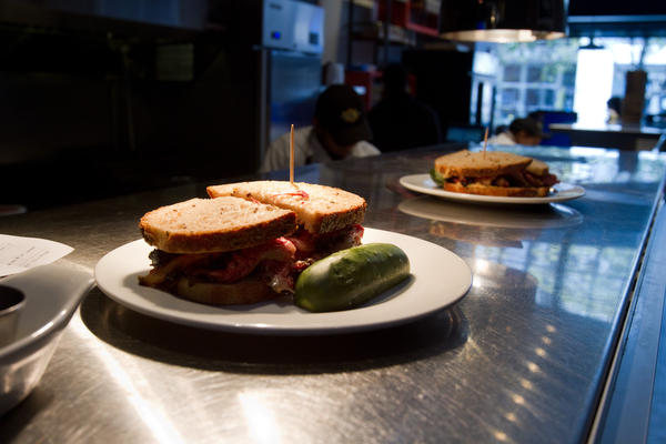 DGS' signature pastrami sandwiches and pickles.