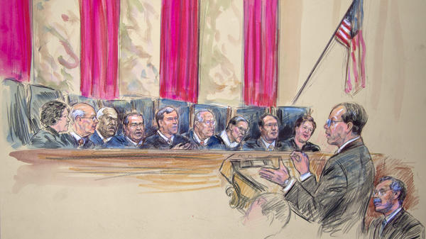 This artist rendering shows Paul Clement (second from left) with Solicitor General Donald B. Verrilli Jr. (seated, right), addressing the Supreme Court on Wednesday. Justices pictured are (from left) Sonia Sotomayor, Stephen Breyer, Clarence Thomas, Antonin Scalia, Chief Justice John Roberts, Anthony Kennedy, Ruth Bader Ginsburg, Samuel Alito and Elena Kagan.