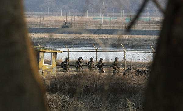 South Korean soldiers patrol along a barbed-wire fence near the border village of Panmunjom on Wednesday.