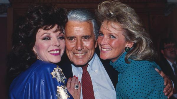 Joan Collins, John Forsythe and Linda Evans at a party celebrating the production of 150 episodes of <em>Dynasty</em> in 1986.