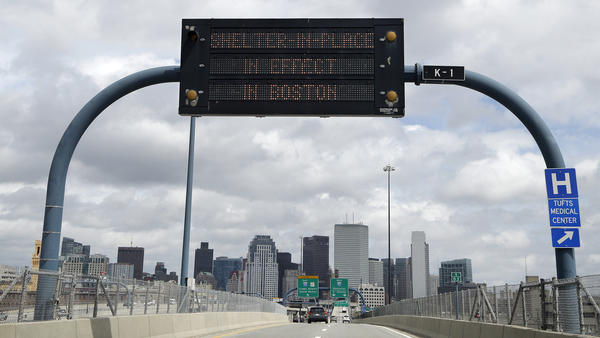 "A sign on I-93 alerts motorists that Boston is under a ""shelter in place"" order Friday."