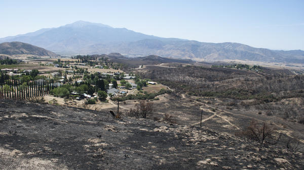 The Summit Fire burned hot and fast up the Banning Pass area, near Beaumont, Calif., on May 1, leaving a moonscape in its wake. Houses that had cleared brush and wood from around their property were left unscathed.