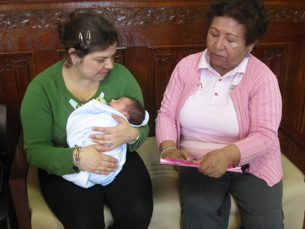 Elva Jaldin, a <em>promotora,</em> talks with Andrea Velandia about health. Soon Jaldin will help women like Velandia sign up for health insurance under the Affordable Care Act.