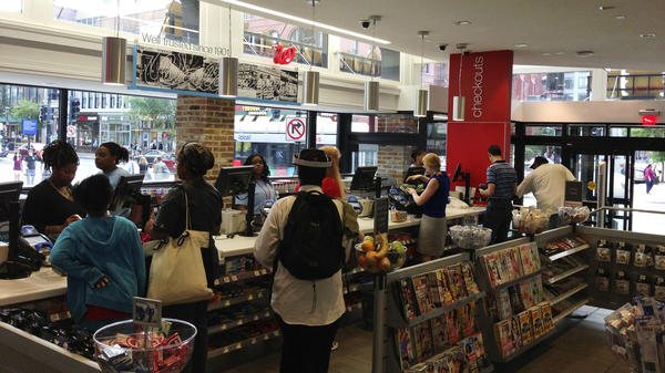 Customers check out at the new flagship Walgreens in Washington, D.C.'s Chinatown.