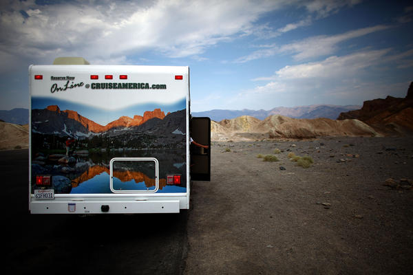 A motor home parked in the lot of Zabriskie Point. The official world record high of 134 degrees was set 100 years ago in Furnace Creek.
