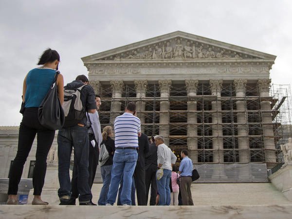 People wait in line for the beginning of the Supreme Court's new term on Oct. 7.