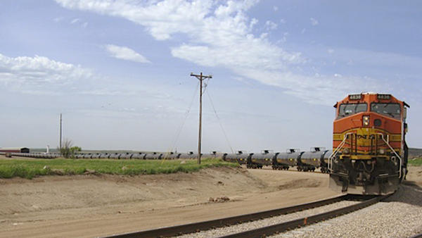 A train leaves the Rangeland Energy company's crude oil loading terminal near Epping, N.D. So far this year, 60 percent of all oil produced in North Dakota left the state by rail. One economist says there aren't enough oil tankers to fill the demand.