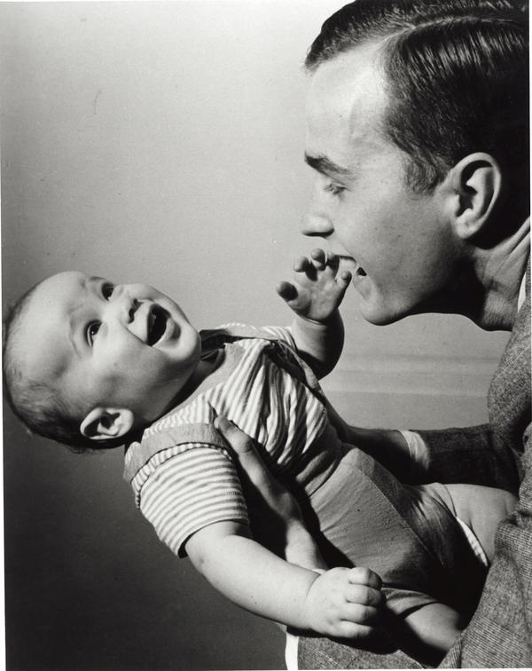 George H.W. Bush holds a young George W. in New Haven, Conn., in April 1947.